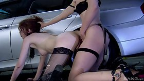 Ballpark strap-on porn in the parking lot with two insolent milfs