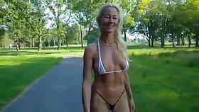 Swiss milf walks helter-skelter a bikini